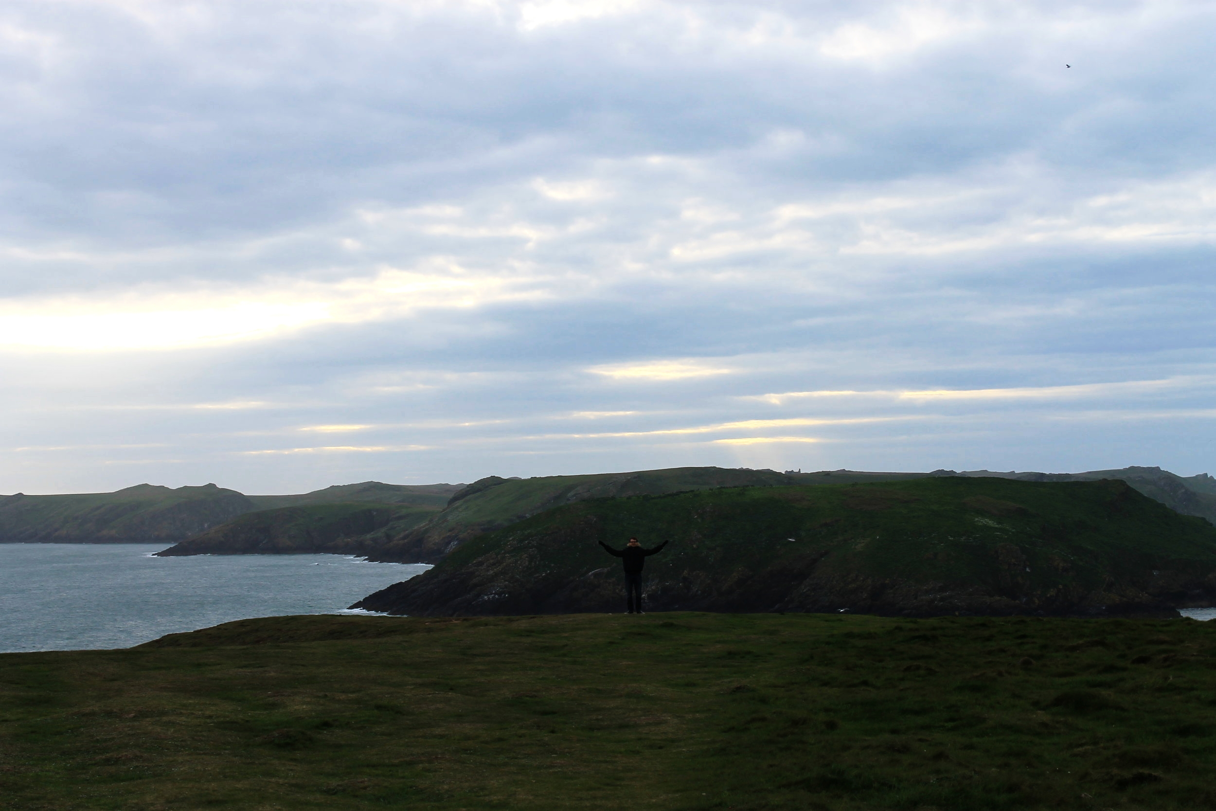 View of Skomer Island at sunset from the Pembrokeshire Coast Path near Martin's Haven
