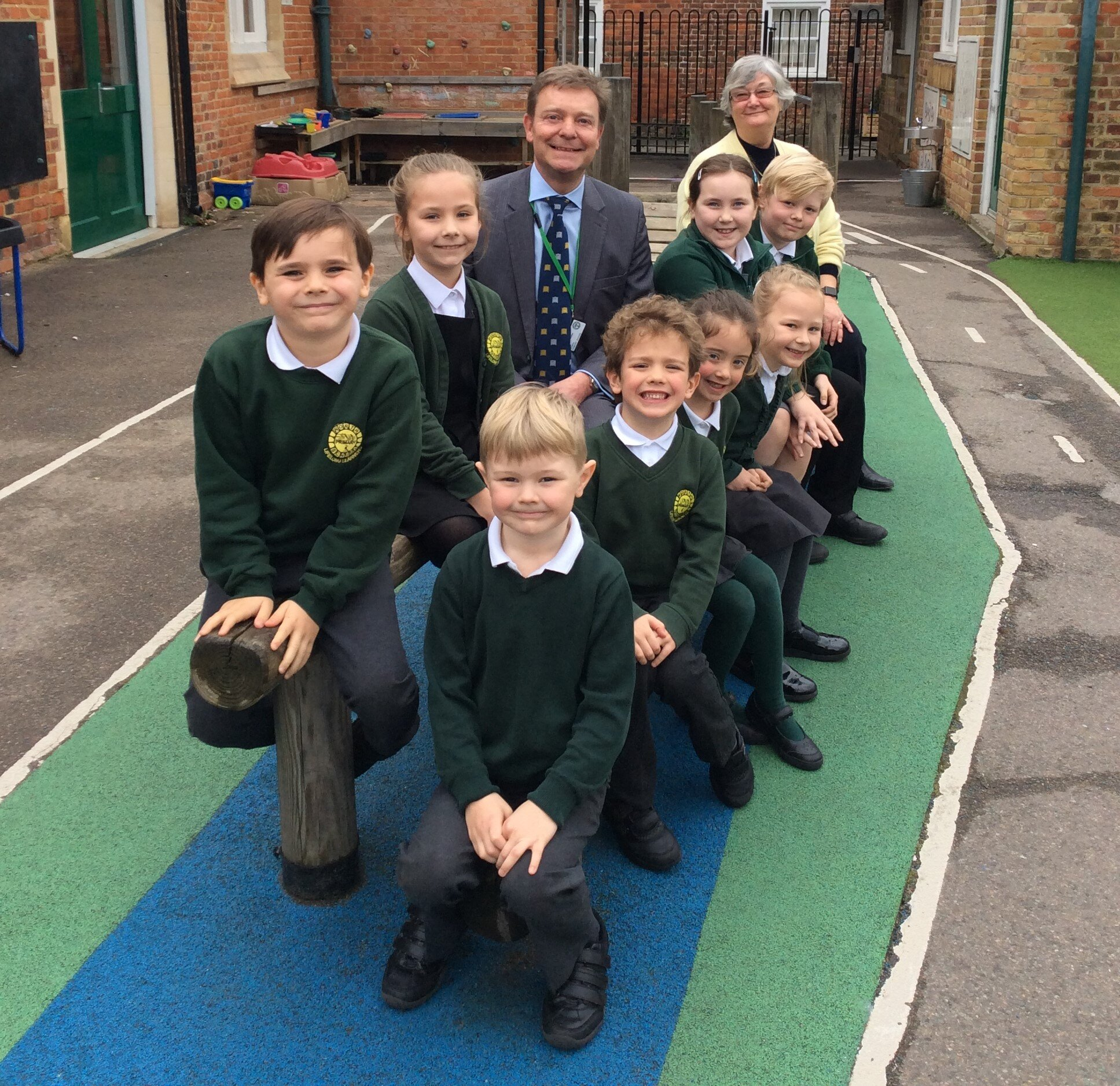 Craig with Worth Primary School pupils in The Street, Worth