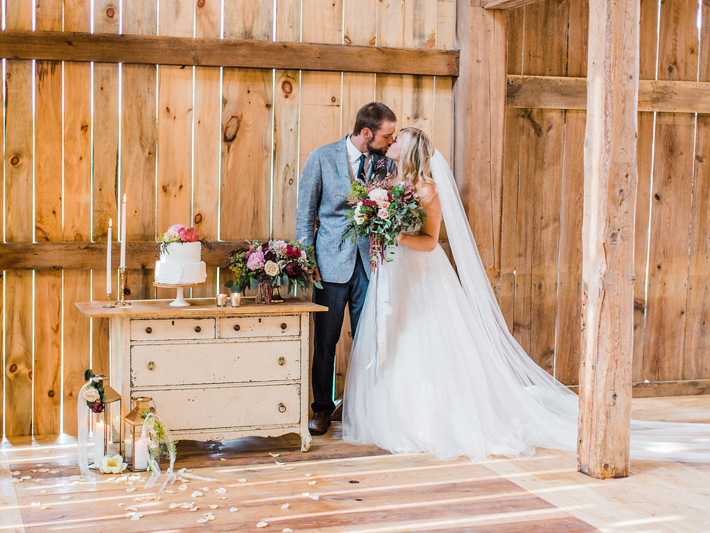 Couple kissing in the reception hall