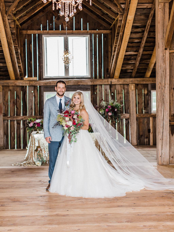 Couple posing beneath the chandelier