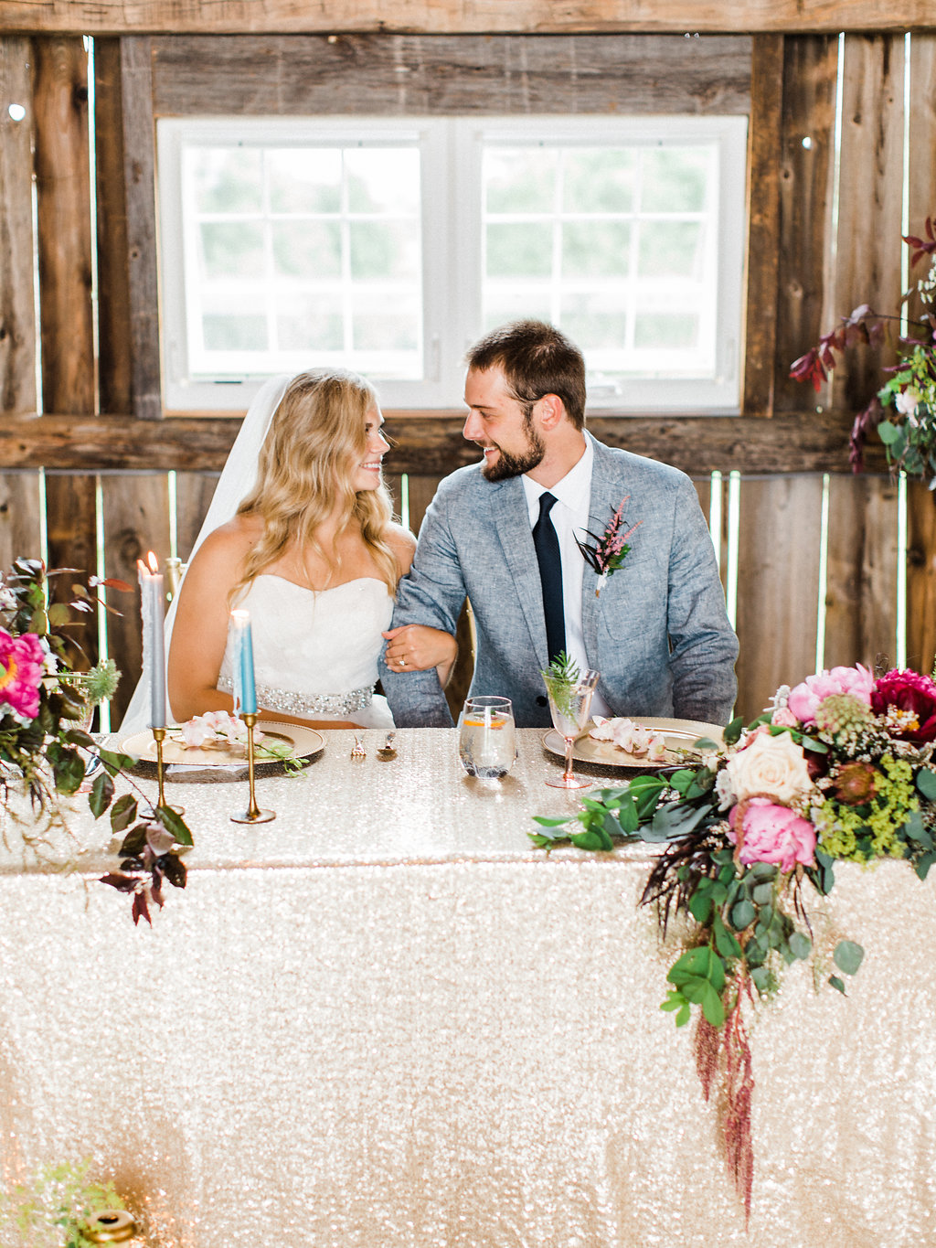 Couple posing at the head table