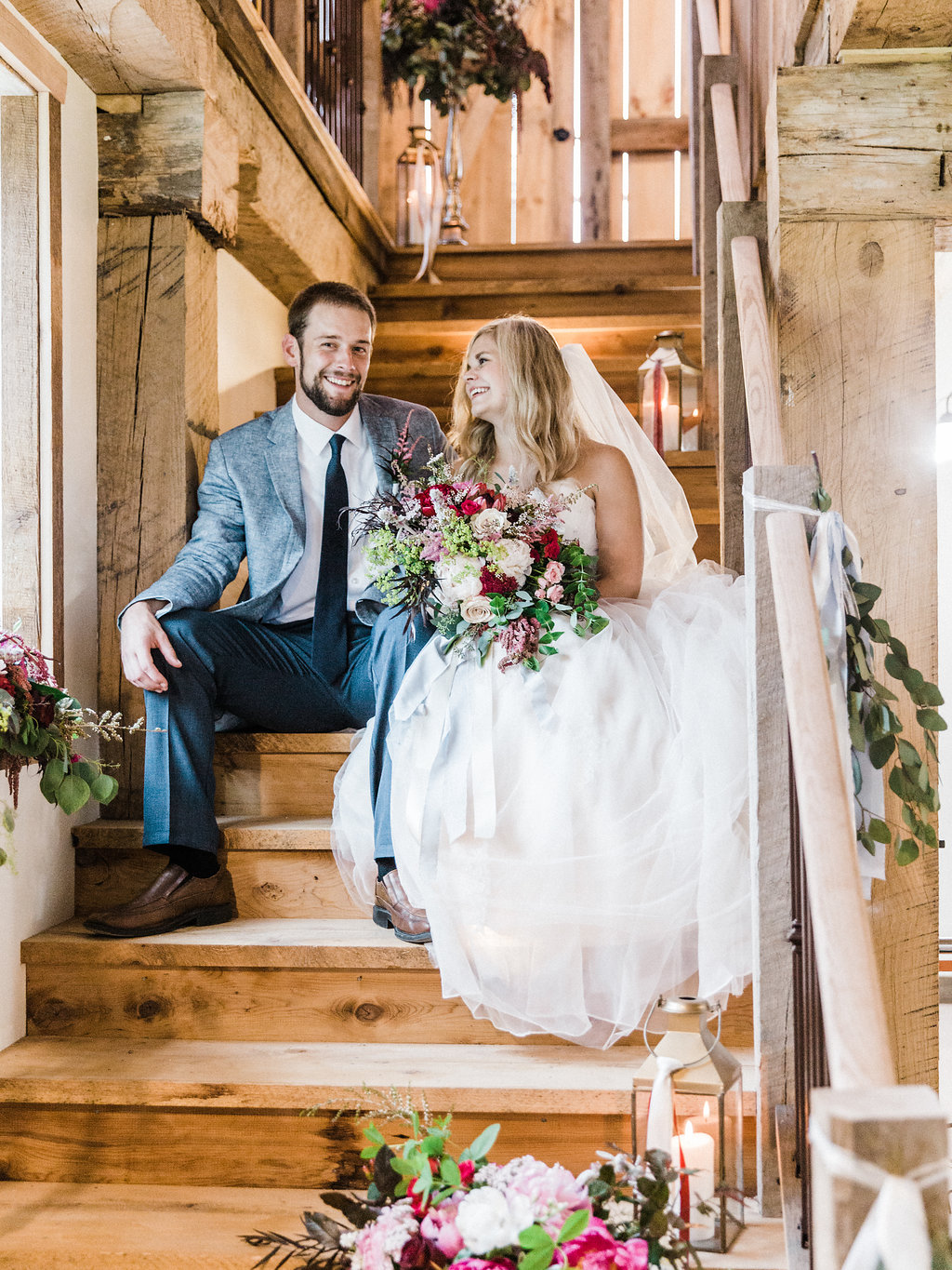 Couple laughing on the stairs