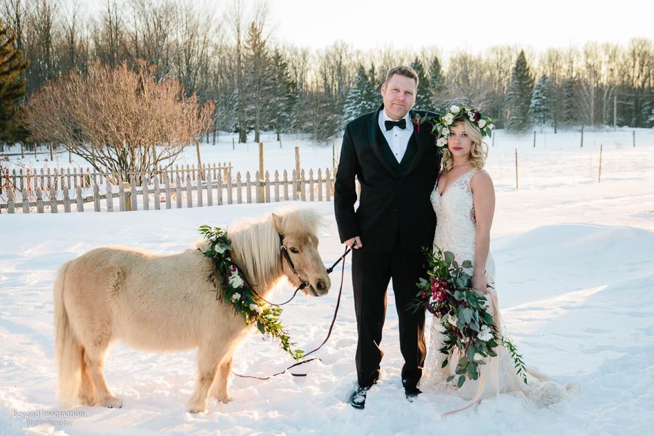snowy wedding flowers and bride groom