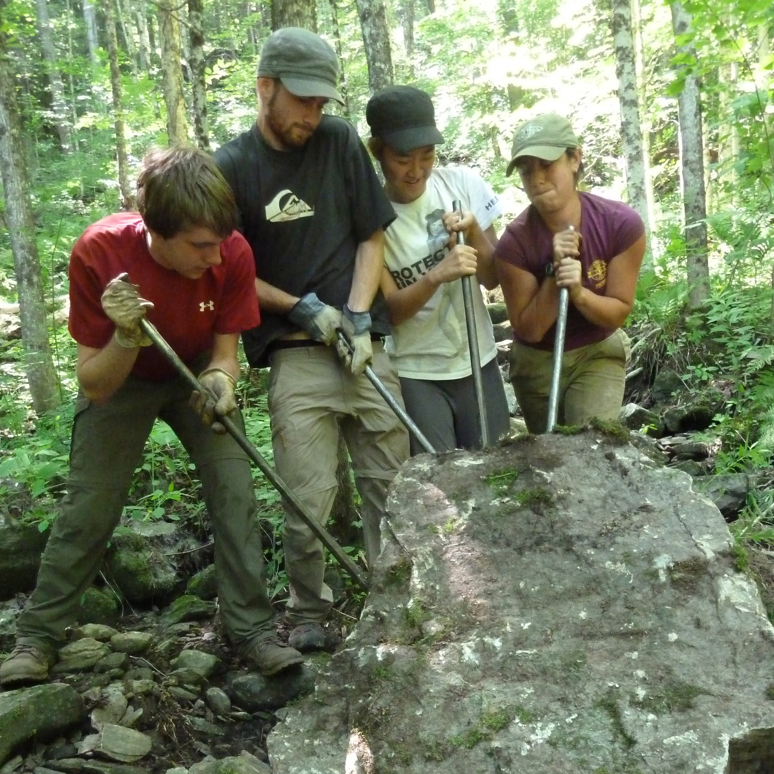 Rock quarrying for stepping stones with international volunteers in Vermont.