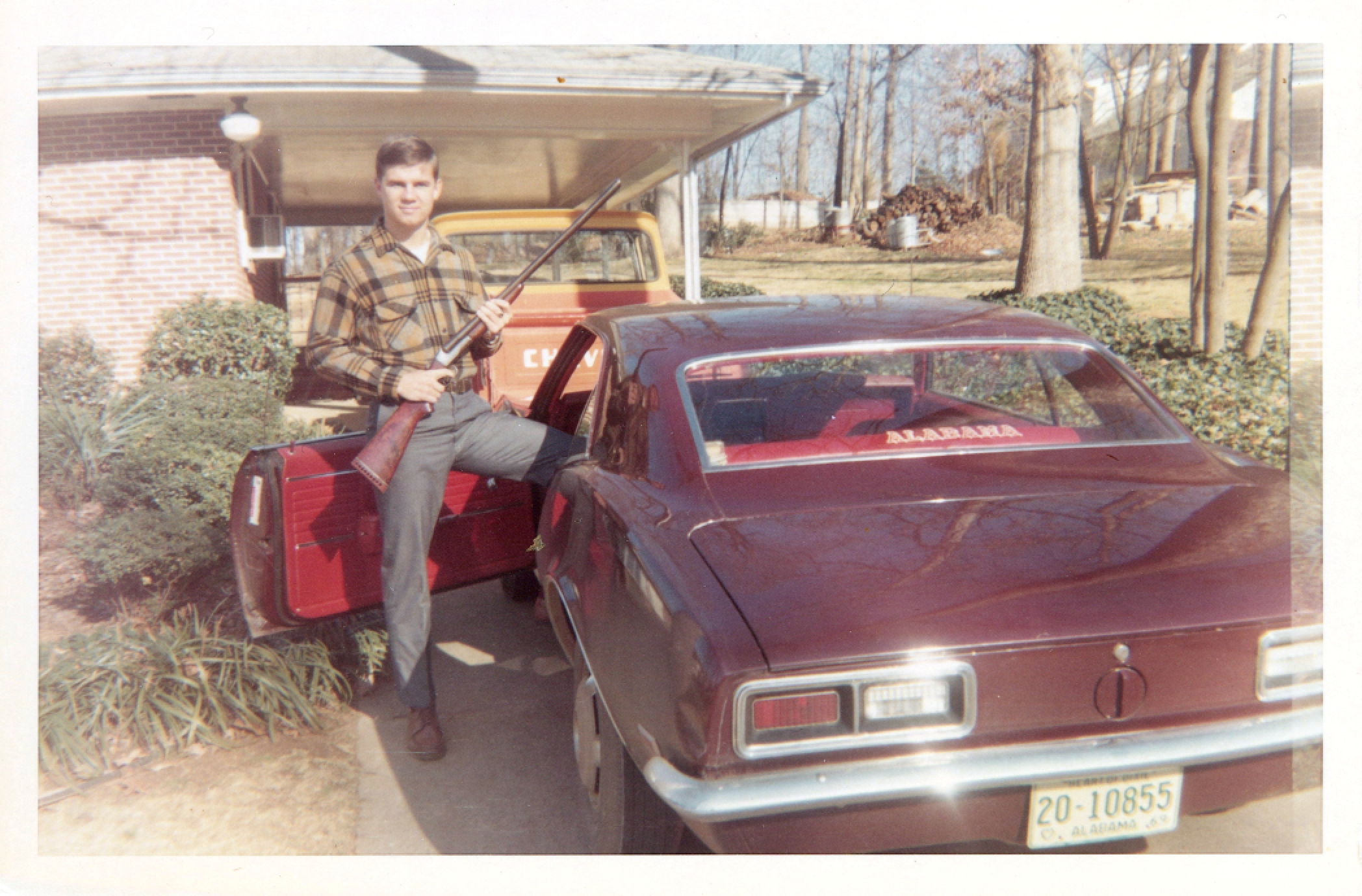 Before dad was a preacher, he had guns! And cool cars! And red vinyl interiors! And amazing shirts that I would totally wear now. #rolltide (c. 1974 maybe?)