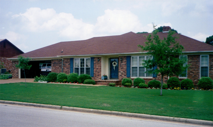 This was our first house in Alabama. I remember dad planting those trees (you should see them now). Mom's minivan is parked in the garage...