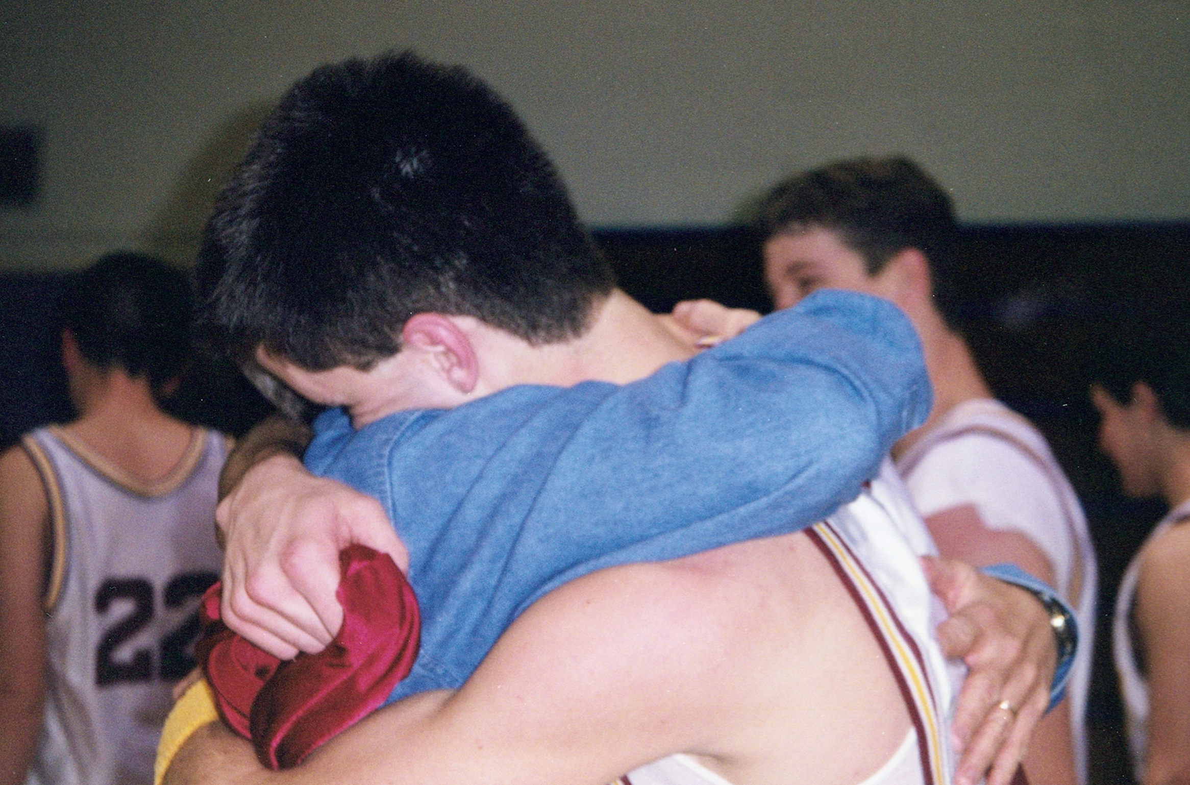 Love this pic someone snapped of dad and me after a basketball game. Spring 2000, probably.
