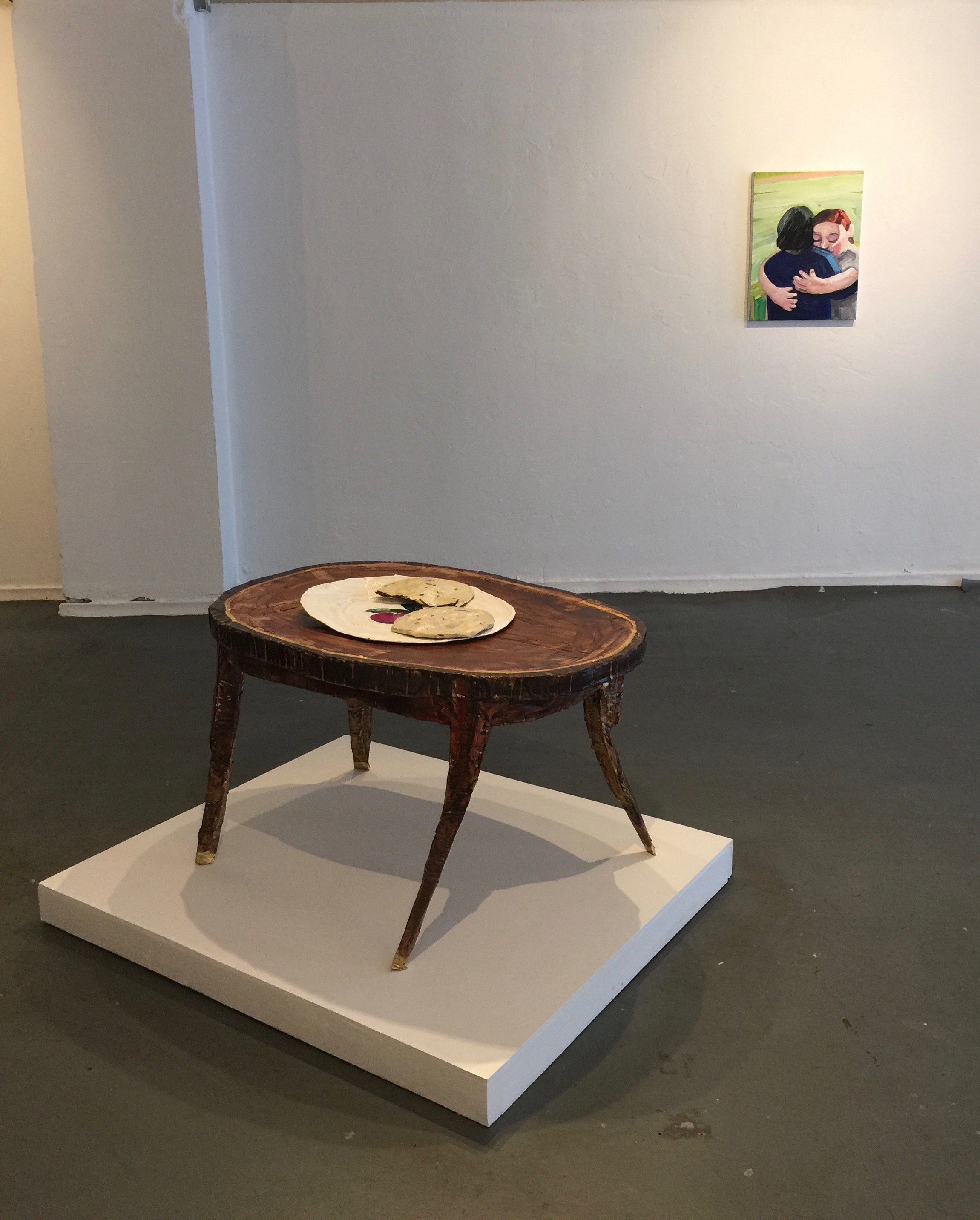 Installation image with  Coffee Table with Cookies  (2017), Acrylic on cardboard and masking tape on wood pedestal