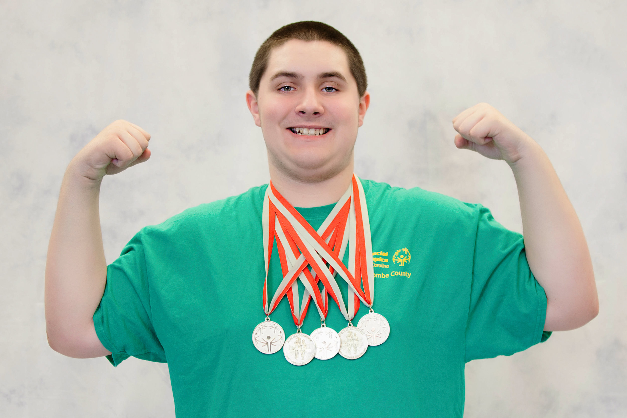 Such pride in his accomplishments with the Buncombe county special olympics.