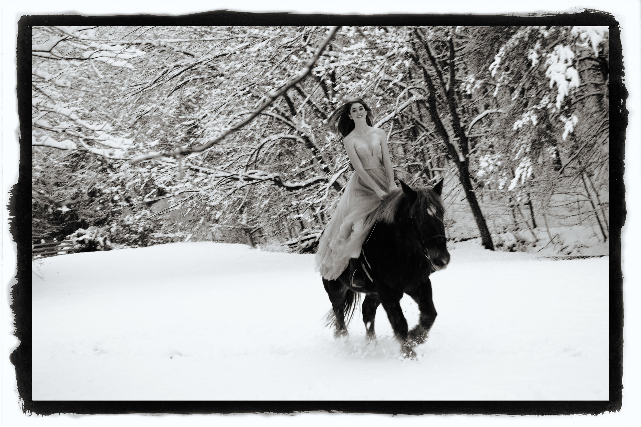 riding her horse - shoot in the snow - fairy tale photo shoots for high school seniors