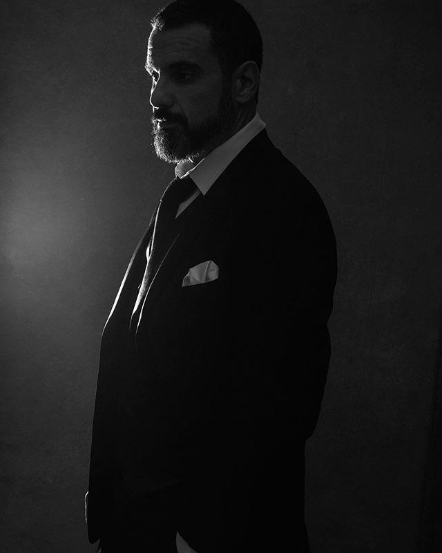 """What hurts you, blesses you. Darkness is your candle."" - Rumi MUSE: @stonetreecreative PHOTOGRAPHER: @catfordcoates GEAR: @canonusa  5dmark4 1.2 LIGHT: @profotousa @profotoglobal #shotbycat #stayinspired #catfordcoates #vanityfair #photographingmen #thathighlighttho #dapper #fashioninspired #portrait #portraitphotography #pursuitofportraits #suebryceeducation #007 #blackandwhite #vogue #editorial #rumi #ashevillephotographer #theworldismystudio #avl #cre828 #asheville #ncportraitphotographer #profoto #canonphotographer #myexposureedit"