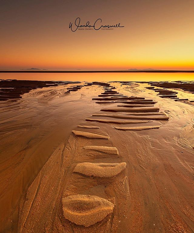 How adorable are these sand ripple shapes here on a gorgeous morning in Mackay, Queensland! I just spent four fascinating days up here, being the keynote speaker at the mini-PSQ conference, making new photography connections, shooting at a few new locations and a few locations I've been to before, and arriving home yesterday being very exhausted ……It was an invigorating and special weekend in this stunning Queensland town with palm trees, beaches, pastel skies, red skies, yummy food at local cafes and restaurants, smooth and craggy rocks, and wonderful generous hospitality by all who picked me up and dropped me off at the airport, accommodated me, drove me around endlessly, lent me a car, lent me a tripod when I misplaced mine overnight (oops), and listened to my high energy babbling on two mornings about my two passions, photography and travel. Thanks for the memories! xx . I've got ONE SPOT left on my upcoming 5-10 November small group photography workshop in Tassy.....see link in bio, and I'm around this week to chat about it with you! . *Authorised re-seller for NISI, Sirui and Sunwayfoto products.* Private photography workshops. NEXT Tasmania photo workshop: 5-10 November 2019!  hello@wandacraswellphotography.com  _________________________________________ 📍: Mackay, Queensland, Australia 📷: Canon 6D 🕶: Canon 16-35mm f4 🔭: Sirui W1204 tripod ◼️: NISI v6 + ND3stop + soft grad 💡: f11  8s  ISO100  16mm _________________________________________ #sand #beach #seascapephotography #phototours #photographyworkshops #photoworkshops #iteachphotography #irunphototours #travelphotography #travel #landscapephotographer
