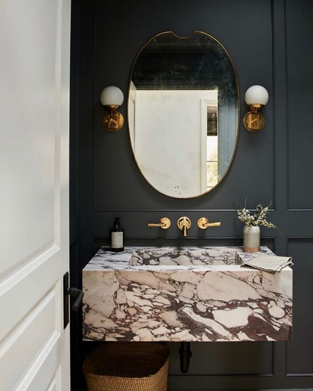 @amberinteriors making all my bathroom dreams come true. I've been obsessed with painting walls in my recent designs really dark grey or even black. It creates such a sultry and dramatic mood which is just what some spaces crave. ⚡️