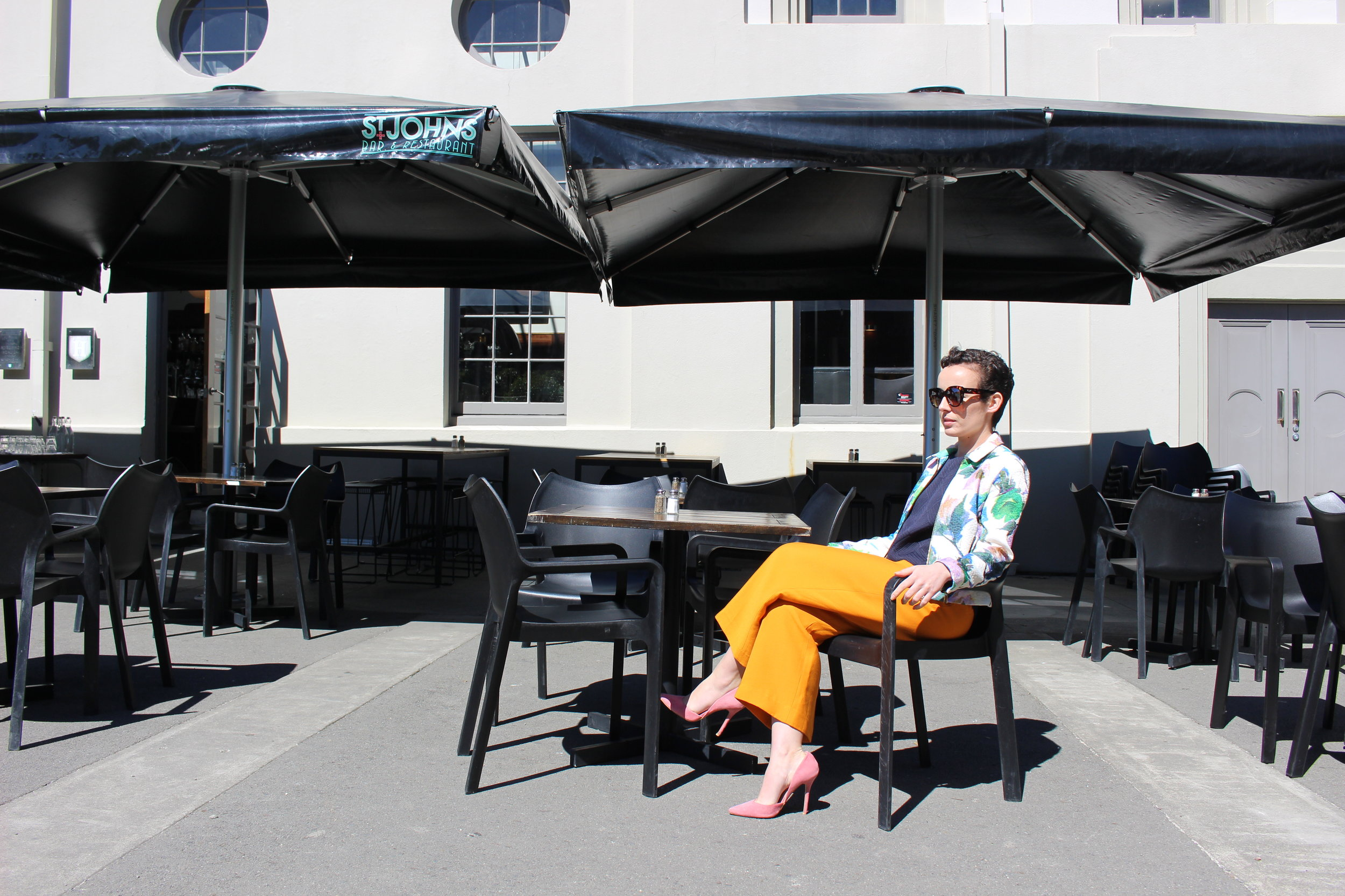 Waiting in vain for a cocktail half as colourful as my outfit