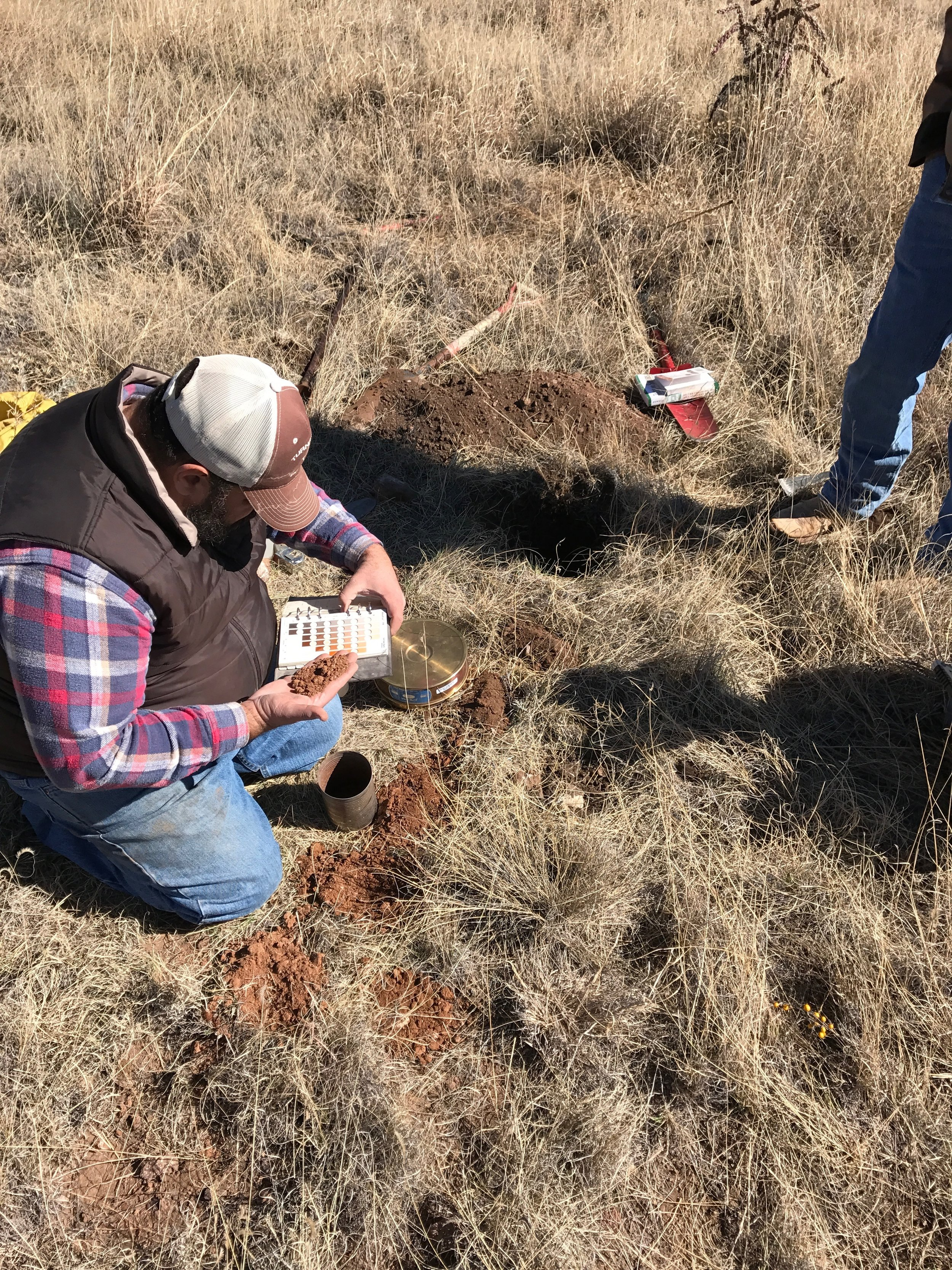 David Jalali, soil scientist from the NRCS in Marfa, classifying soil color.