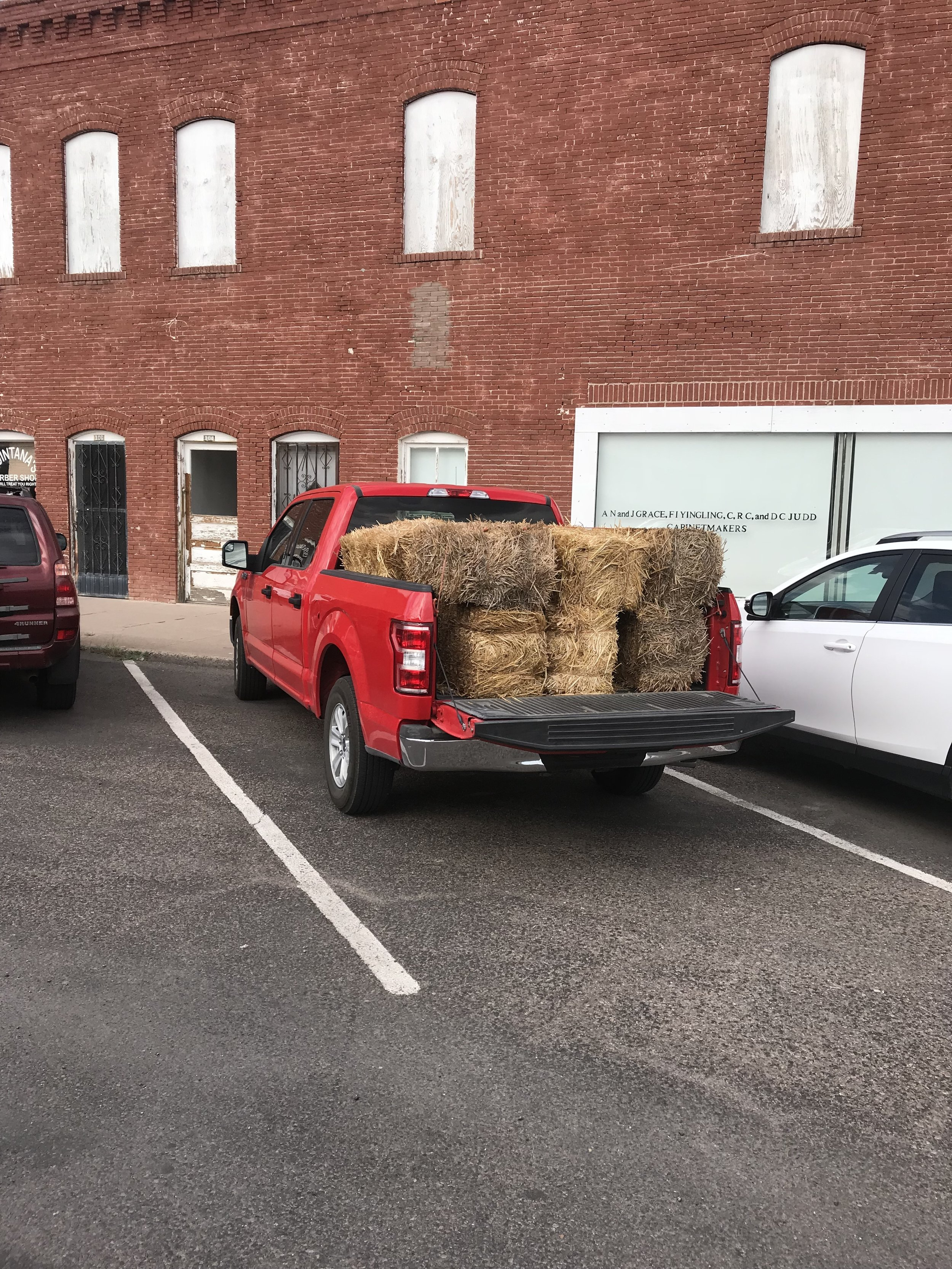 Driving around Marfa with a truck full for straw.