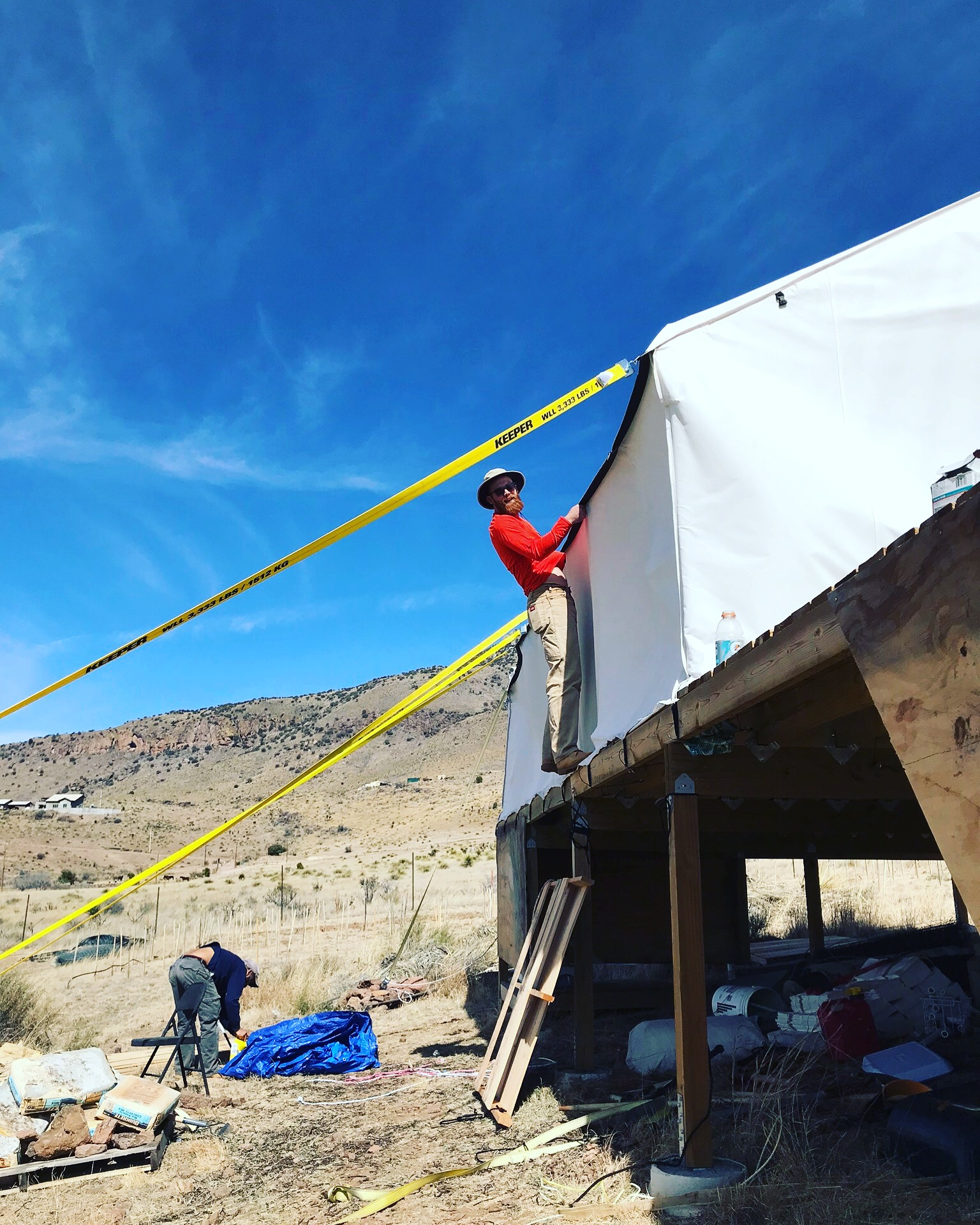 I have never felt more like a pirate than this moment. We got some heavy duty straps to make sure the tent doesn't blow away. During the winter and spring we routinely have 30-40 mph winds.