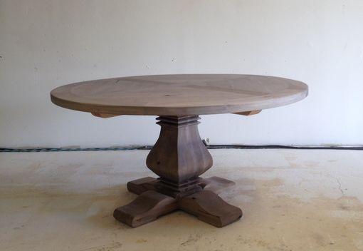 Jeff Santini Round Pedestal Table.jpg