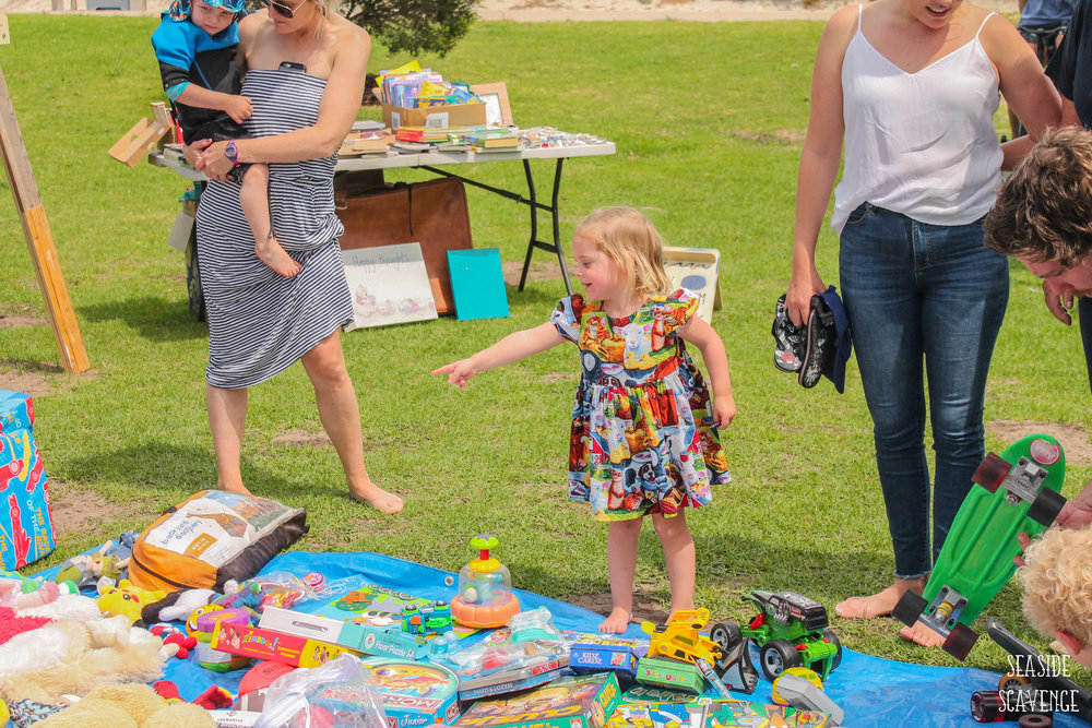 child_choosing_toy_market.jpg