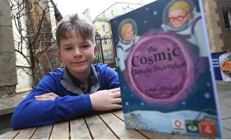 Award winning child author, Jona David, 13, with his new book, The Cosmic Climate Invention..Pic - Richard Marsham.