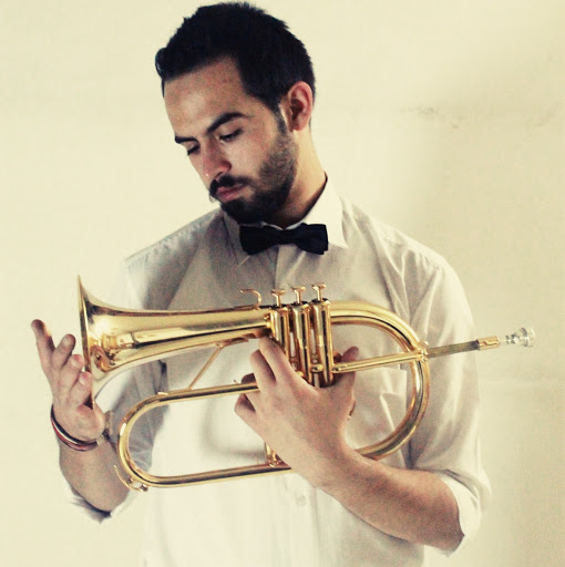 MILAD KHAWAM - Composer  Milad is one of a handful of trumpeters in Syria, playing since he was 10 years old. When Milad left Syria he didn't bring his trumpet, he didn't want anything to happen to it on the way.  He came to Berlin in January 2016. After hearing an interview with Milad online and being mesmerised by his original and hauntingly beautiful music, the NMIB team had to meet him. They got together one night during the film shoot in Berlin. Over a cup of coffee Milad decided that he would compose and play the original score for  No Monsters In Berlin .
