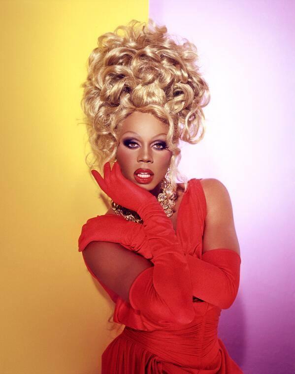 """<a href=""""https://www.vogue.com/article/rupaul-drag-queen-race-interview"""" target=""""_Blank"""">VOGUE</a>"""