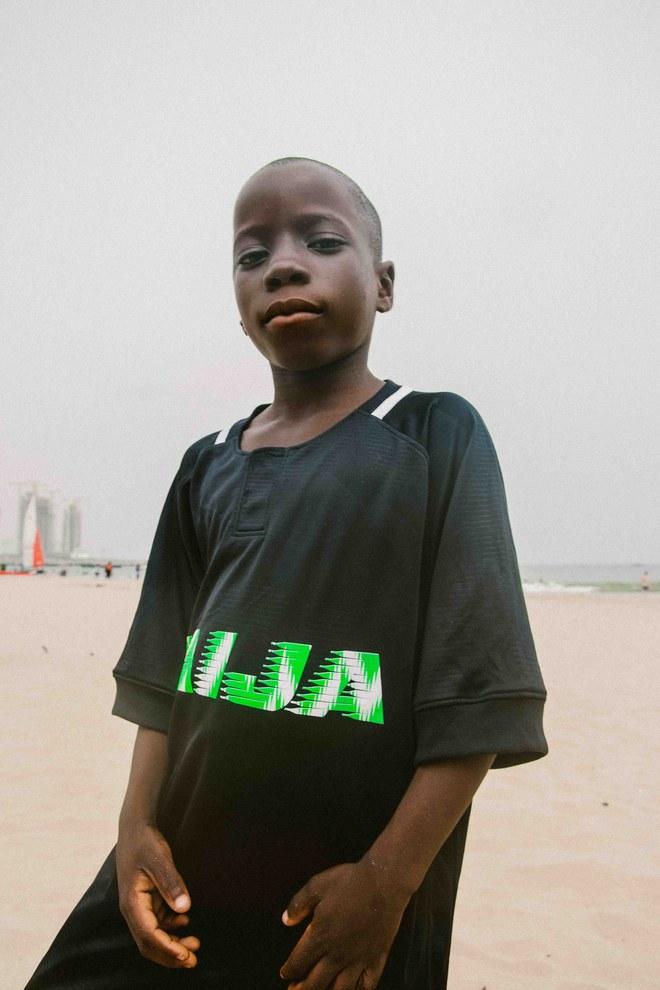 "<a href=""https://www.vogue.com/article/lagos-nigeria-nike-skepta-homecoming"" target=""_Blank"">VOGUE</a>"