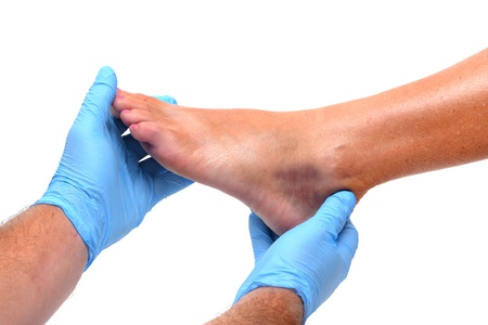 14202058_S_man_foot_podiatrist_examine.jpg