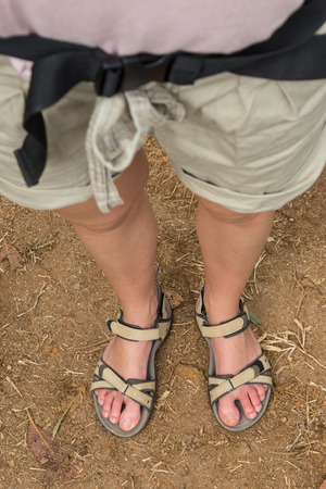 74622386_S_woman_hiking_sandal_legs_toes_wide_dirt_trail_feet.jpg