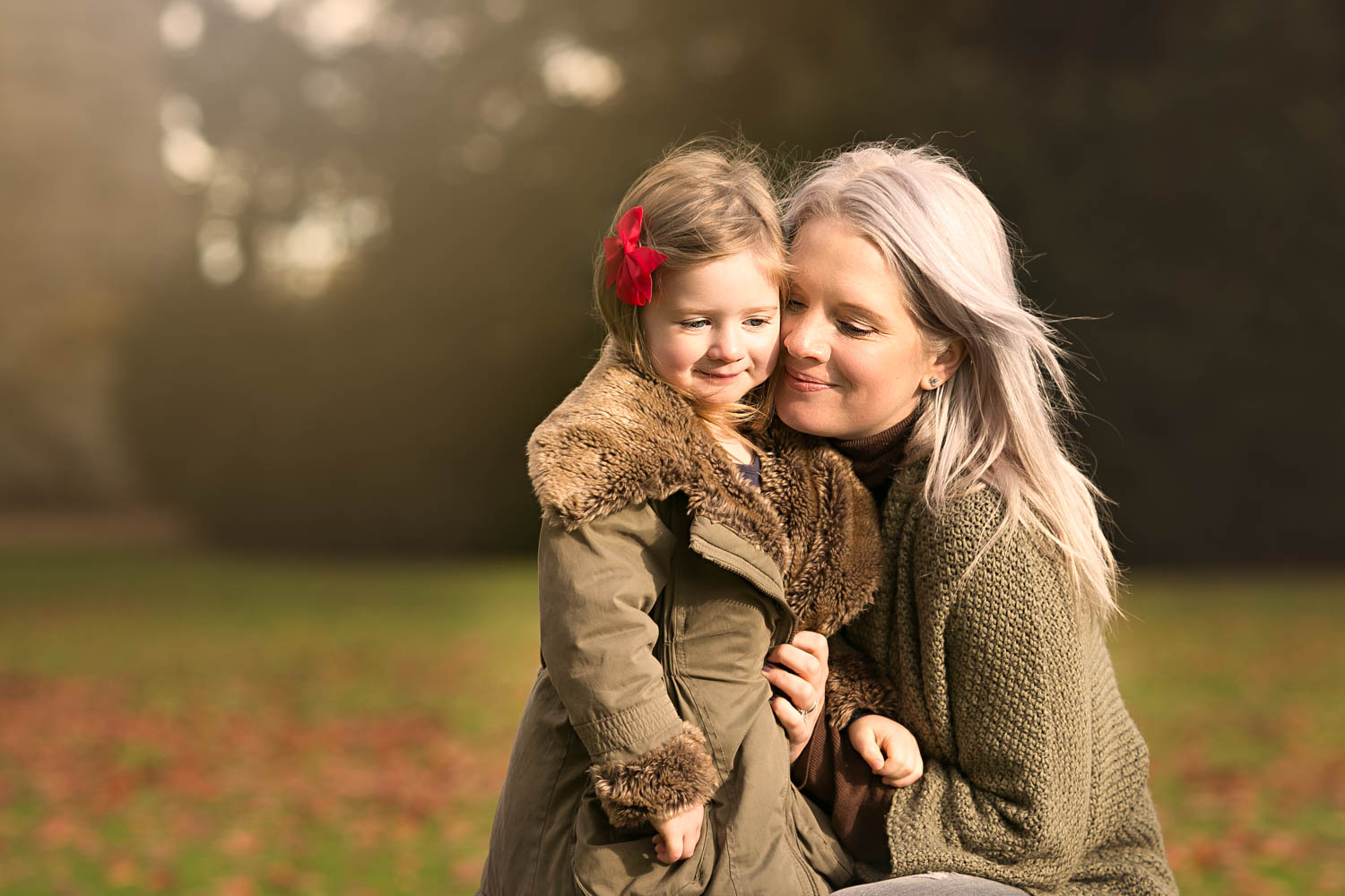 Mother and daughter during family photoshoot   at Castle Ashby in Northampton.