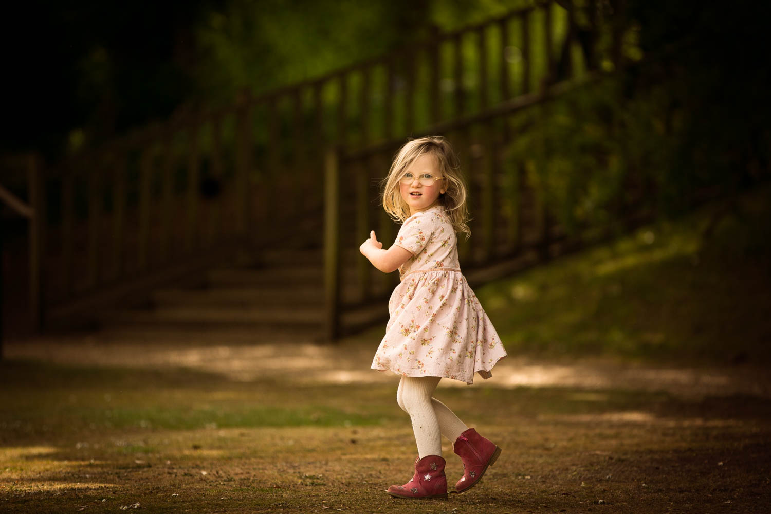 little girl running during child portrait photography session at Castle Ashby, Northampton.