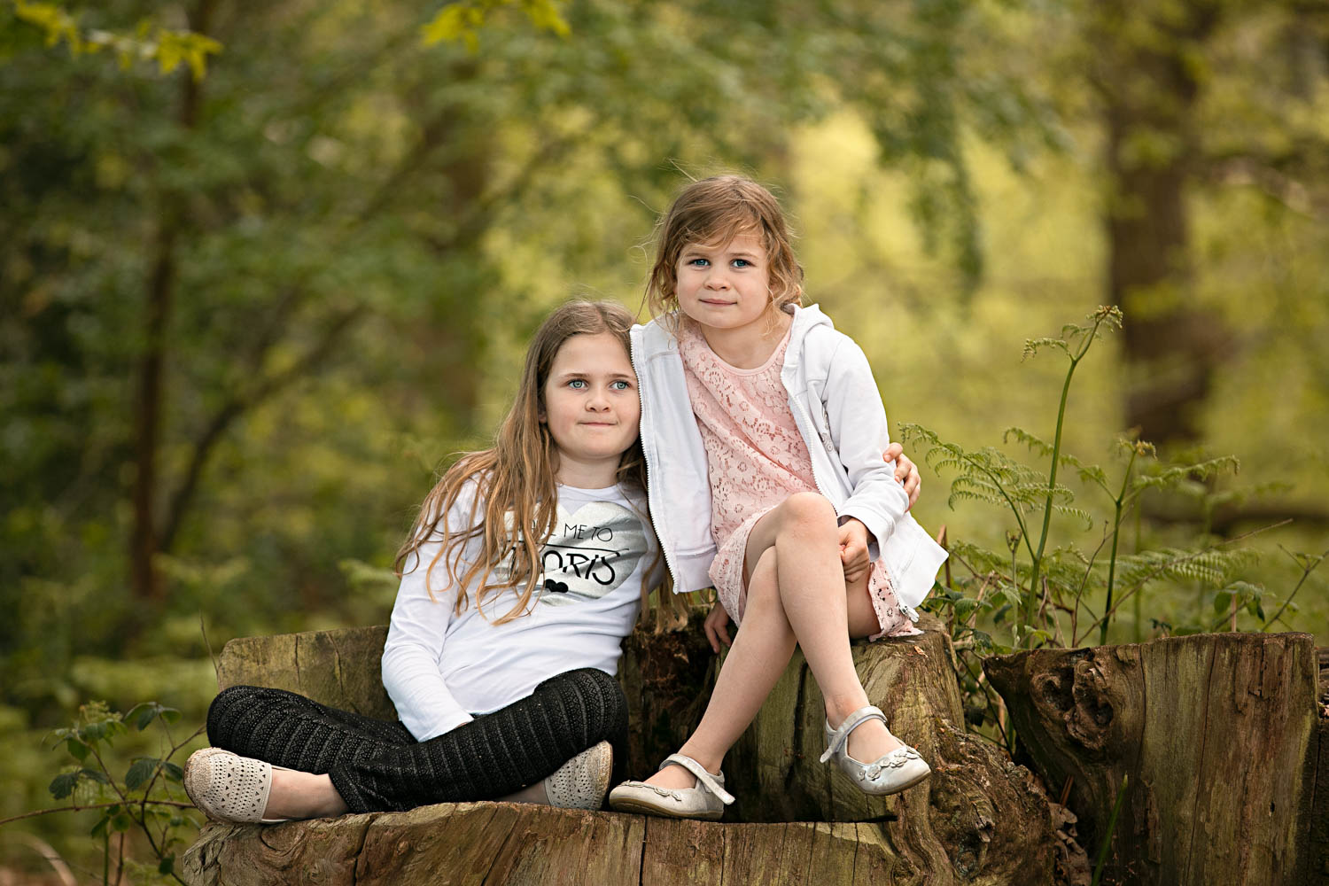 Sisters posing for a family portait.