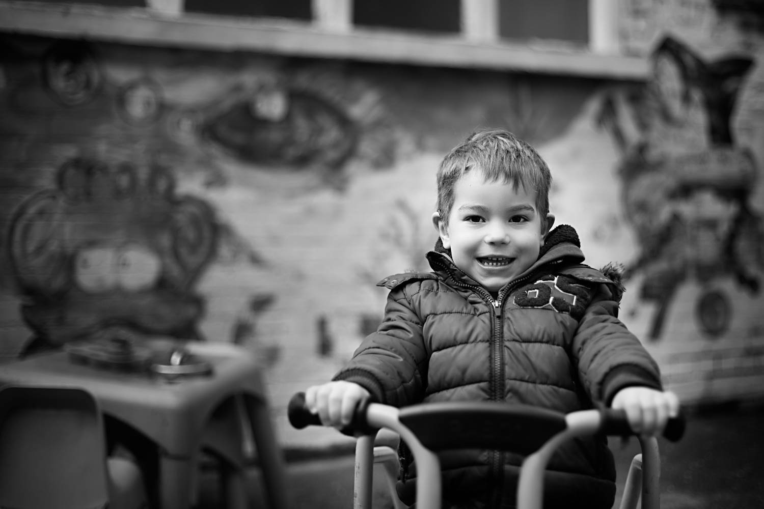 Boy on bike, posing for a portrait during a preschool photoshoot in Turvey Bedfordshire.