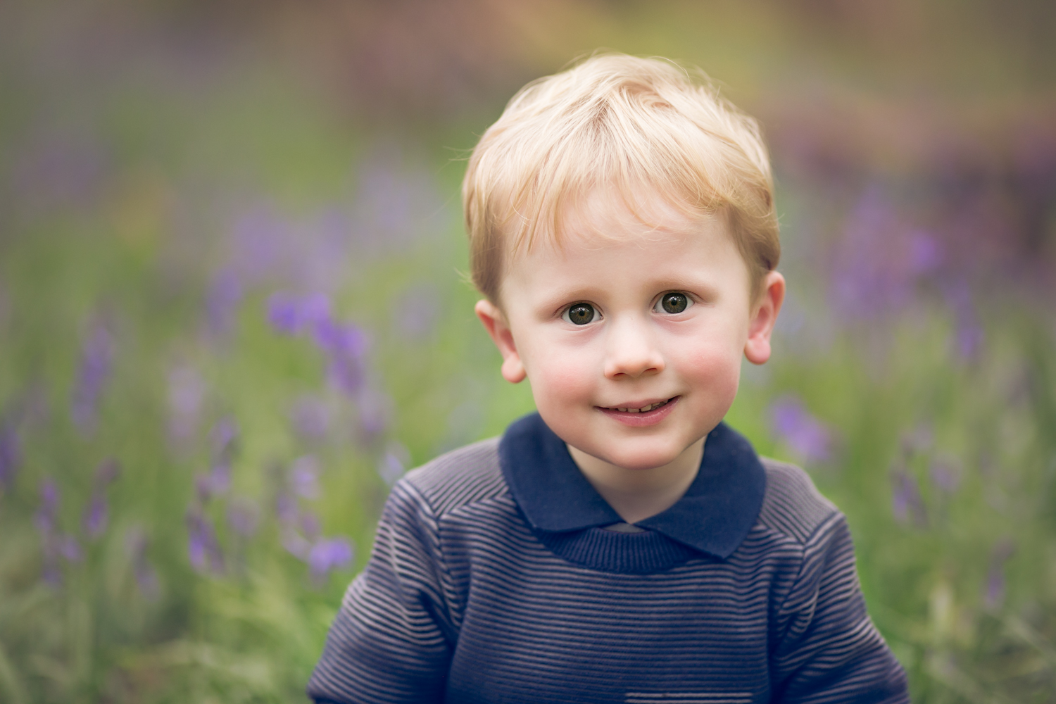 Boy amongst the Bluebells during a Spring Child Photoshoot in Olney, Milton Keynes.