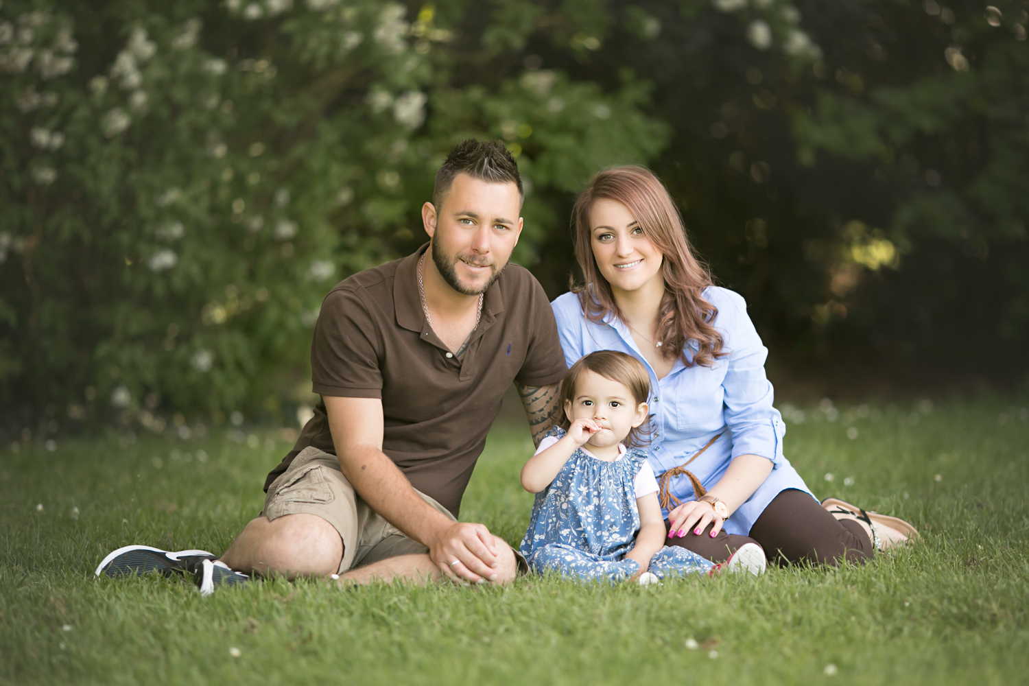 Father, Mother and daughter pose for photos during a Bedford Lifestyle Photography session in Bedford Park.