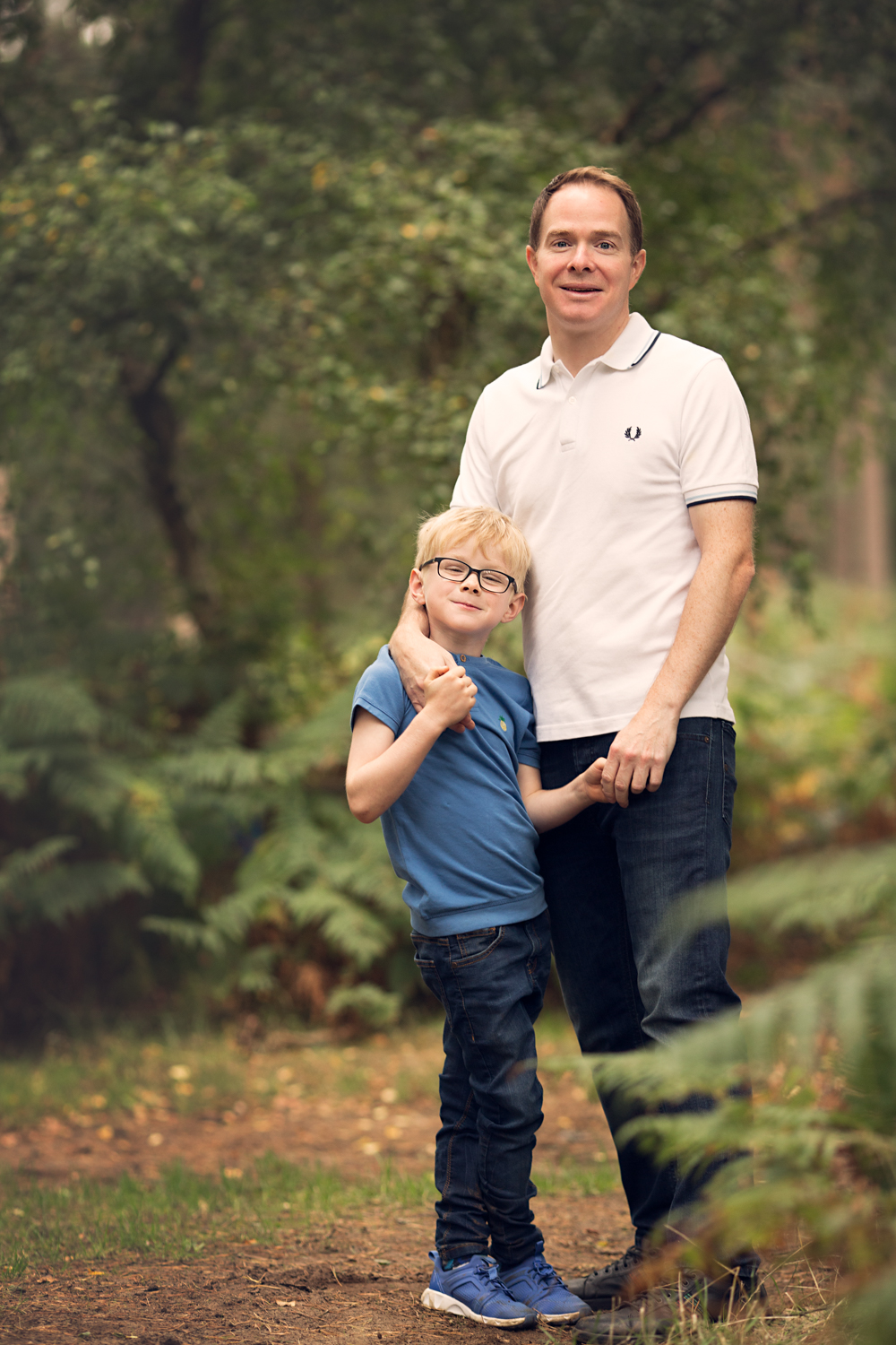 Father and Son pose for a family photo during a family photoshoot at Aspley Heath Woods Bedfordshire