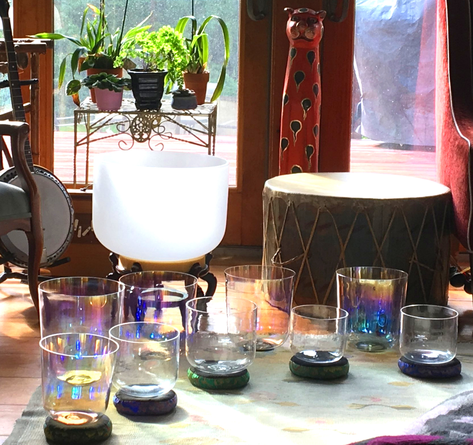 Clear quartz and iridescent Cosmic Ray crystal singing bowls