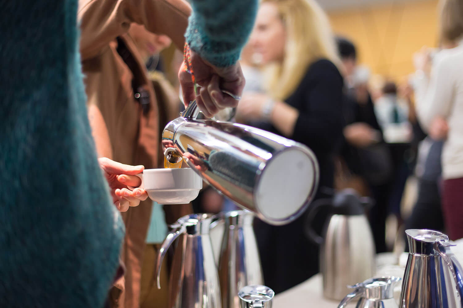 Pouring Coffee at a Zero Waste event
