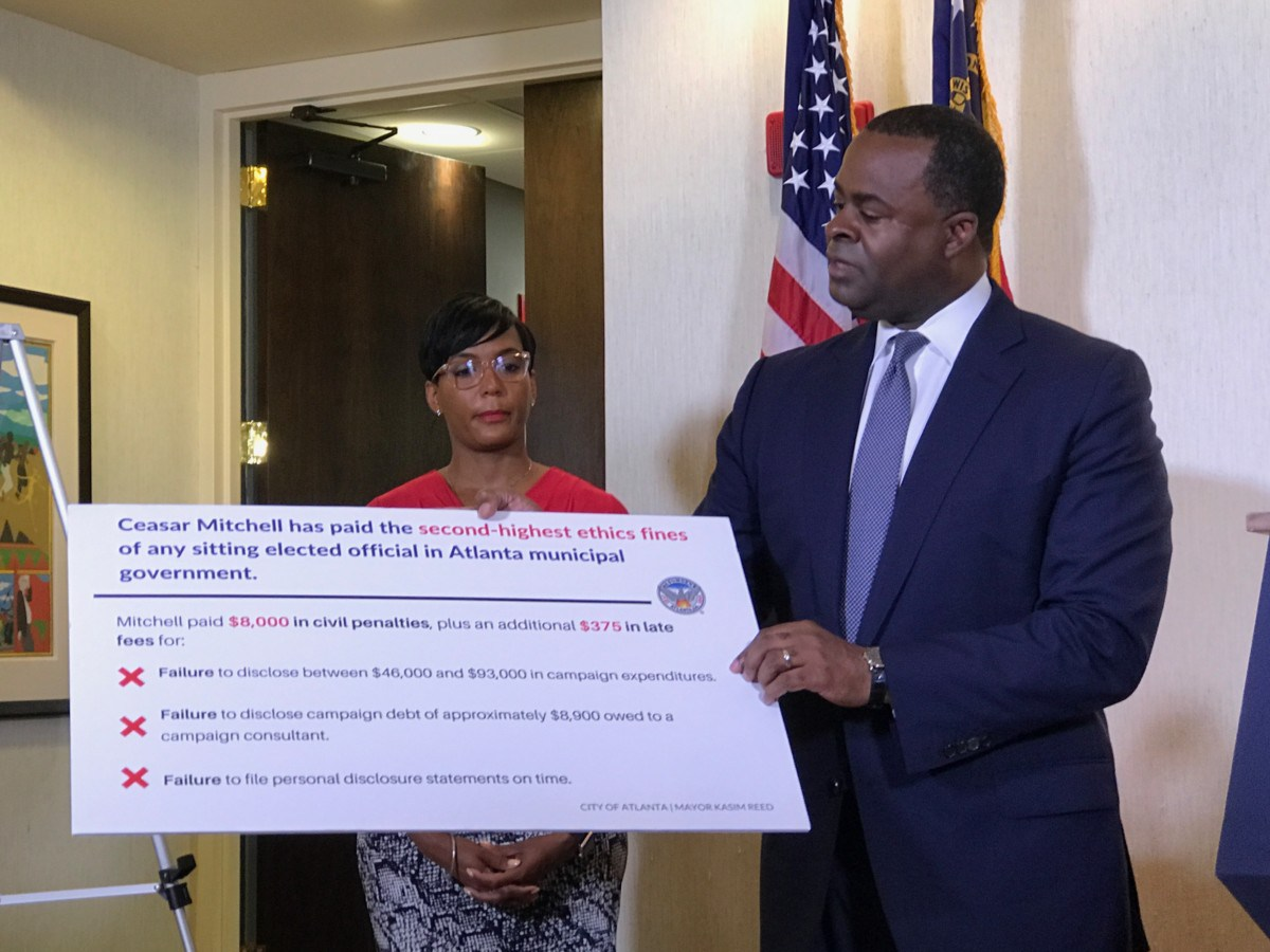 Atlanta Mayor Kasim Reed makes his case against City Council President Ceasar Mitchell as mayoral candidate Keisha Lance Bottoms looks on (Photo by Maria Saporta)