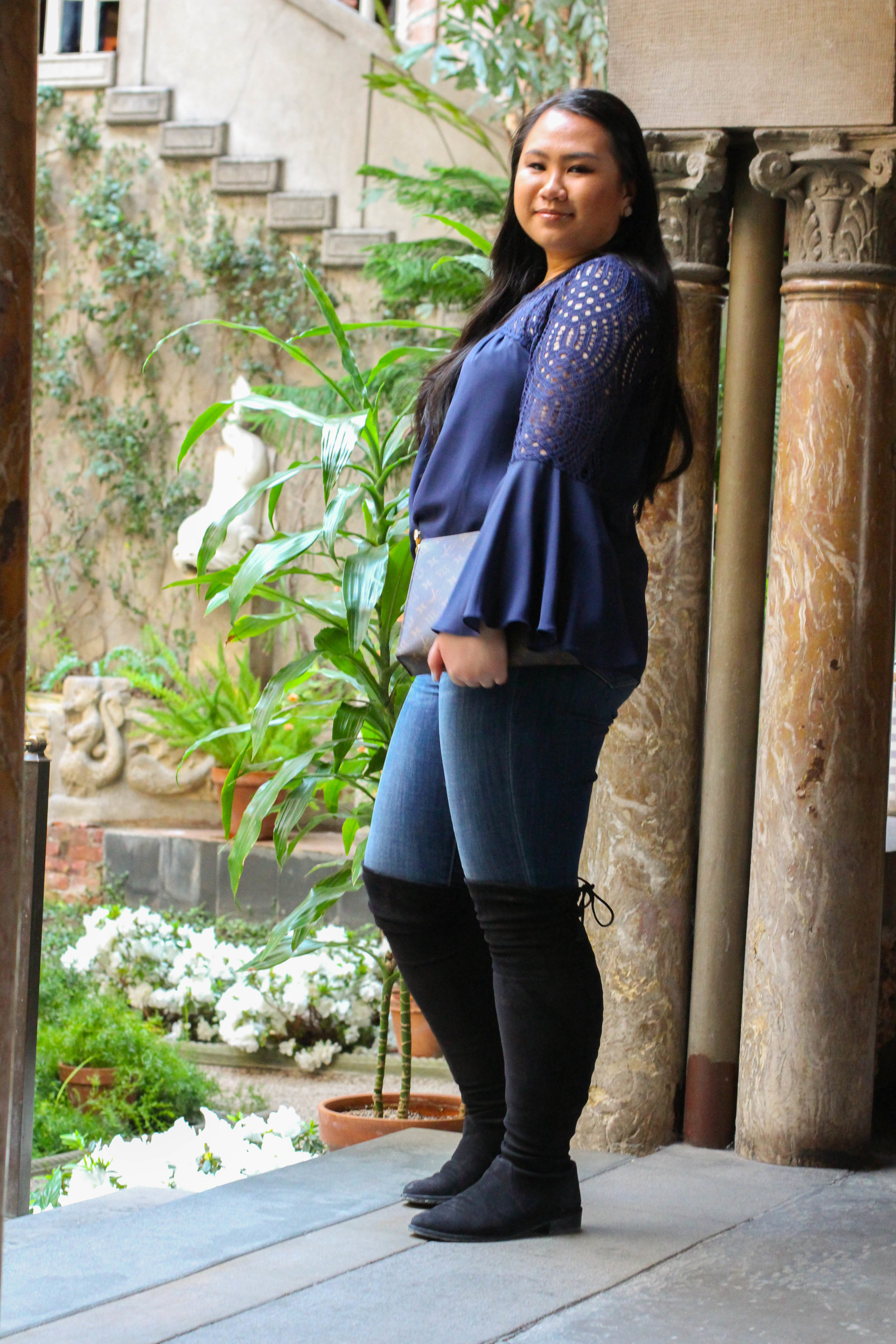 What I am wearing is down below! I love this flouncy navy top from Lilly and these Stuart Weitzman boots are my absolute favorite!