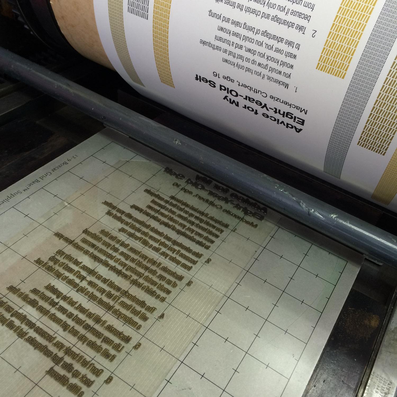 Letterpress printing poetry type on printing press