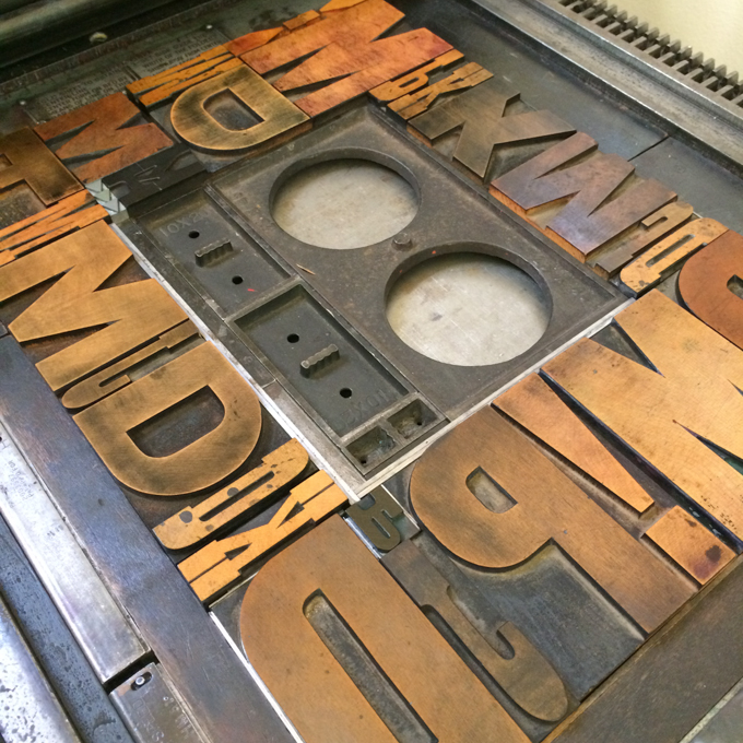 Wood type border on printing press