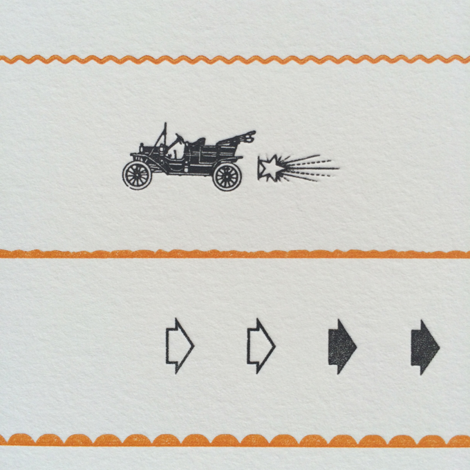 Close up of letterpress print of cars and ornaments