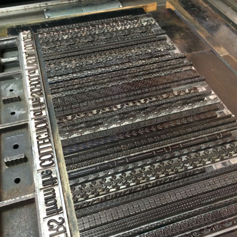 Metal type borders prepared for printing