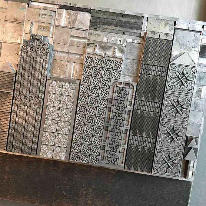 Metal type arranged to form a city