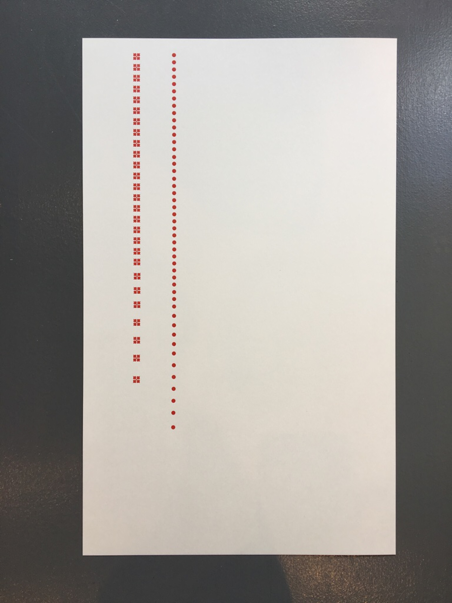 Letterpress print with red dots
