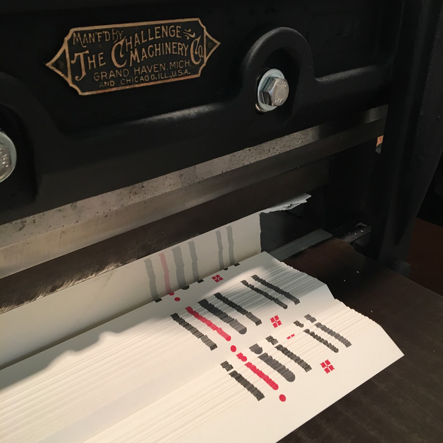 Trimming-prints-on-antique-paper-cutter-CH-2017.jpg