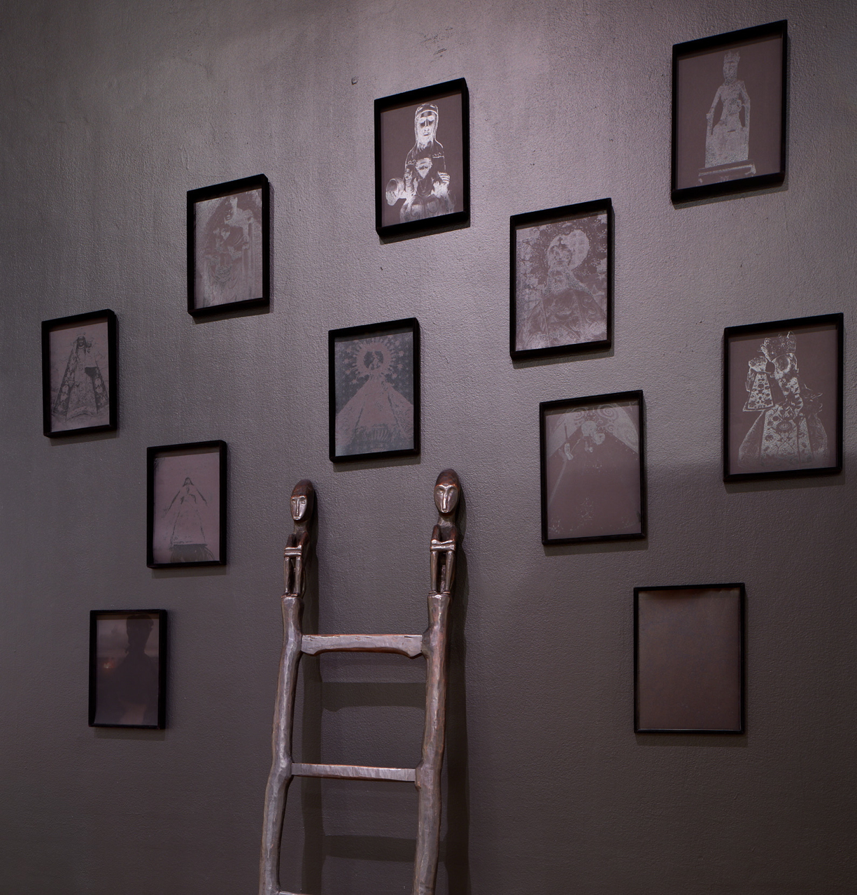 - Installation view: Black Madonnas and Ifugao bulul (rice god) ladderPhoto © Phil Bond