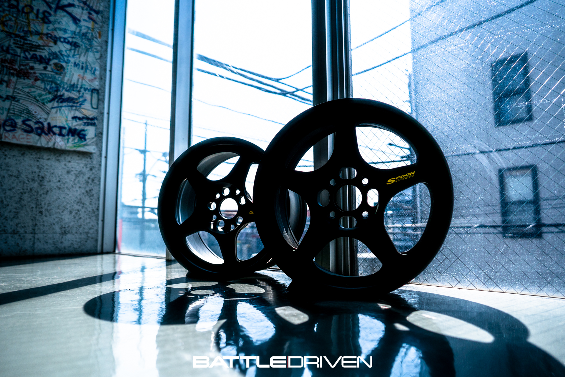 A play on shadows and light with a pair of Spoon Sports SW388 forged wheels by the entrance. Gorgeous.
