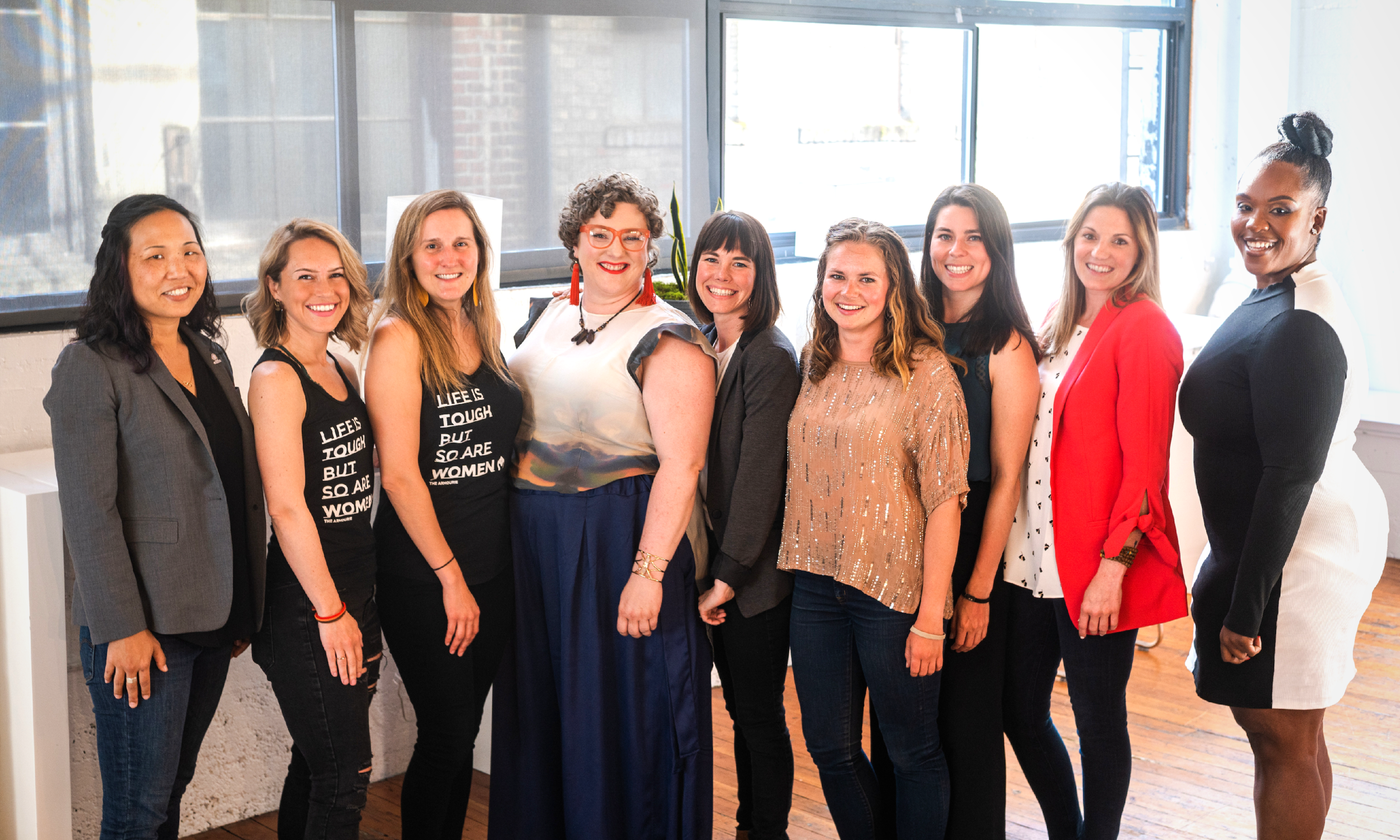 The seven iFundWomen Seattle pitching entrepreneurs (from left to right): Laura Clise, Founder,  Intentionalist ; Alex Pinkerton & Megan Pakula, Co-Founders,  The Armourie ; Hannah Schnabel, Founder,  Belle Ampleur ; Megan Febuary, Founder,  For Women Who Roar ; Genevieve Livingston & Marimar White-Espin, Co-Founders,  Eco Collective ; Sarah Haggard, Founder,  Tribute ; Dr. Cheryl Ingram, Founder,  Diverse City LLC .